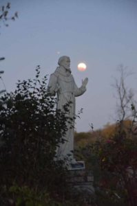 Silent Retreat Weekends - St. Francis Statue at dusk