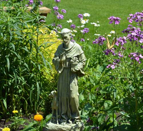 Friends of Francis Retreat - St. Francis in our flower garden